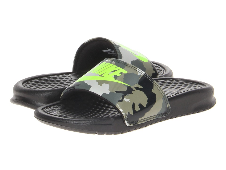 d74120eb58c8f ... Nike Benassi JDI Camouflage-Print Rubber Slides  Nike camo and neon  yellow slides  nike slides for kids ...