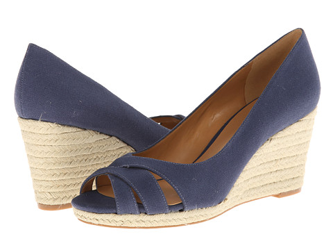 Shop Nine West online and buy Nine West Jelica Blue Fabric Shoes - Nine West - Jelica (Blue Fabric) - Footwear: Step up your summer game with these wanton wedges! ; Easy slip-on wear. ; Leather upper with strapped vamp. ; Man-made lining. ; Lightly cushioned man-made footbed. ; Cork platform and wedge heel. ; Man-made sole. ; Imported. Measurements: ; Heel Height: 2 3 4 in ; Weight: 9 oz ; Platform Height: 3 4 in ; Product measurements were taken using size 8.5, width M. Please note that measurements may vary by size.