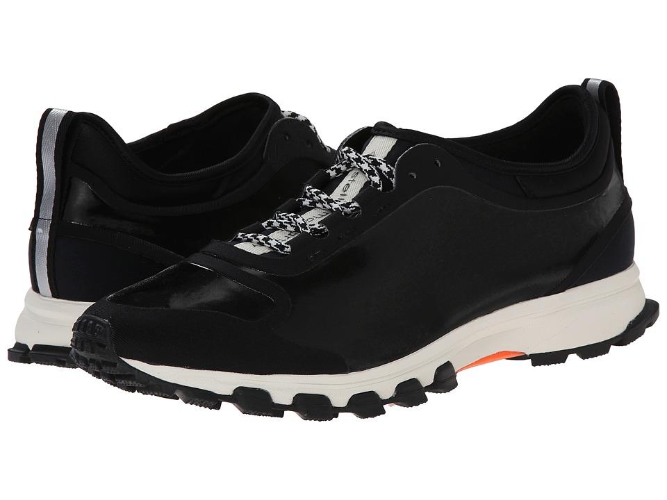 Image of adidas by Stella McCartney - Adizero Xt (Core Black/Core Black/Glow Orange) Women's Running Shoes