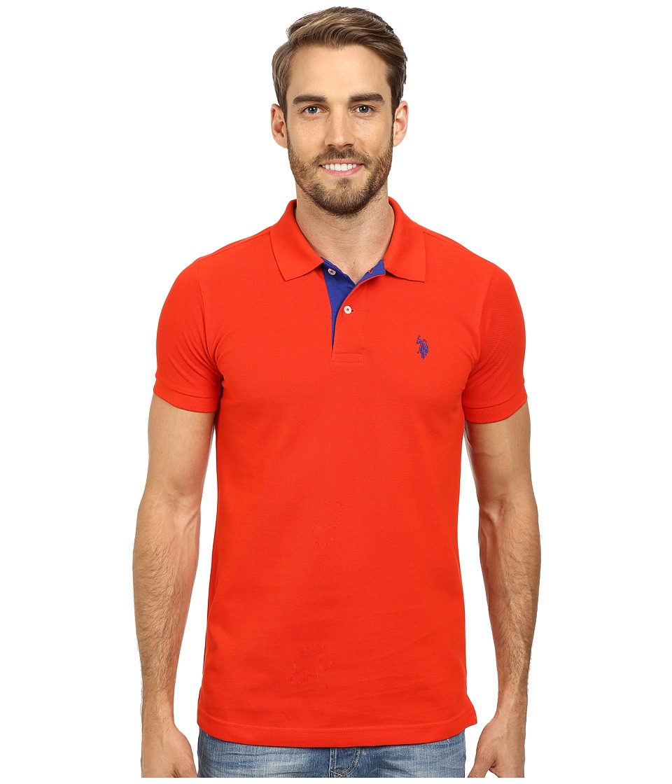 U.S. POLO ASSN. - Slim Fit Solid Pique Polo with Contrast Color Striped Under-Collar (Crisom Fire) Men's Short Sleeve Pullover