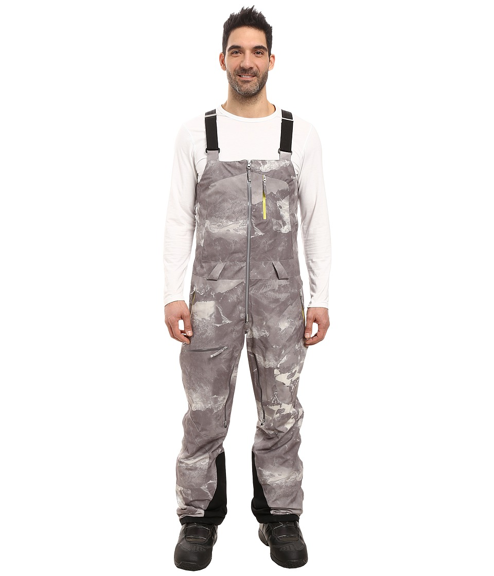 Spyder - Axel Full Side Zip Bib Pants (Mountain Camo Weld Print/Sulfur) Men's Snow Bibs One Piece
