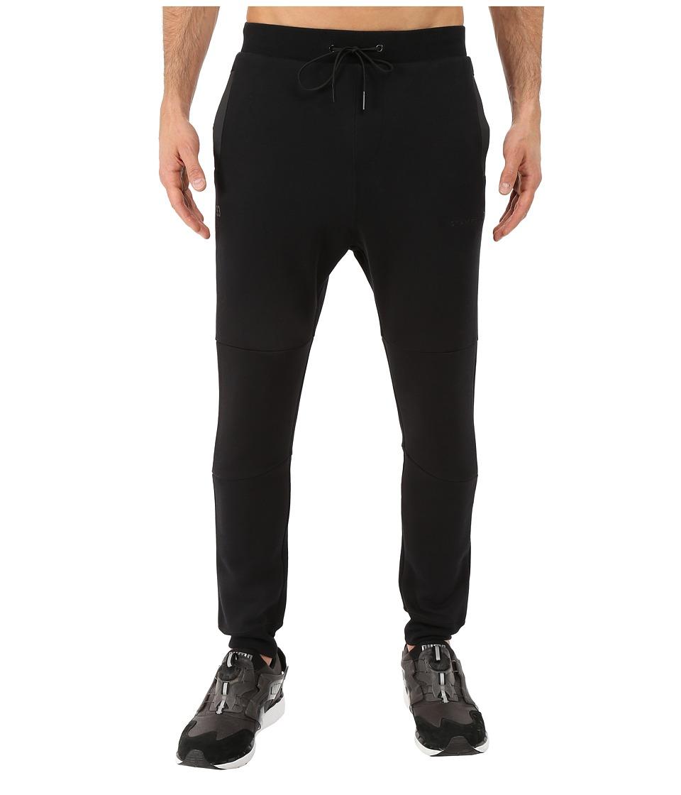 PUMA - Stampd Sweatpants (Black) Men's Casual Pants