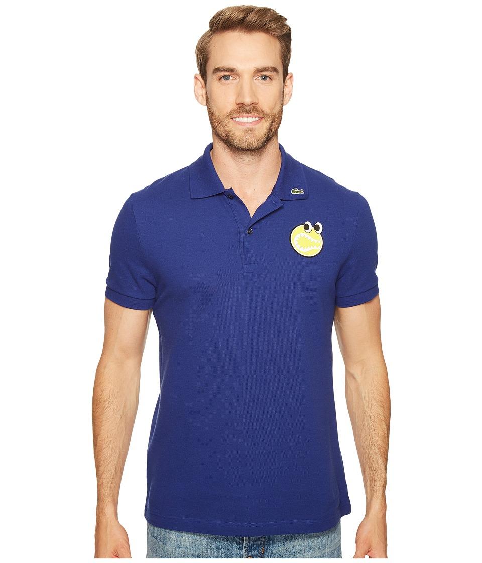 Lacoste - Yazbukey Short Sleeve Pique with Googly Eyes Graphic (Ocean) Men's Clothing